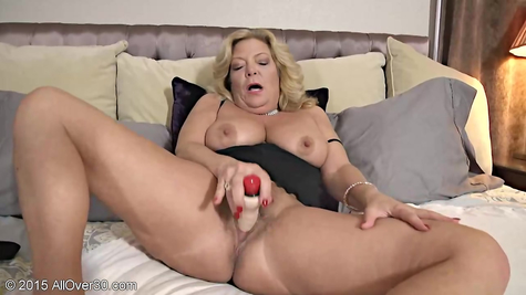 Mature titted mom entertains herself with vibrator