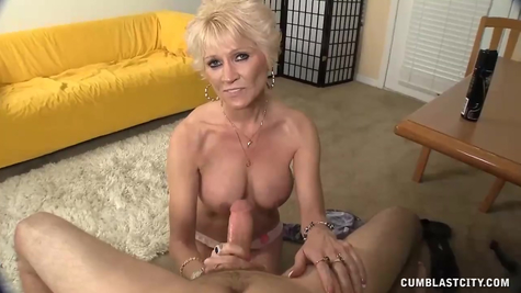 Jerking off a man's dick on camera