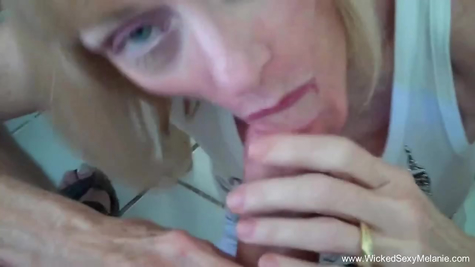 Mature blonde skillfully sucks and fucks in her pussy