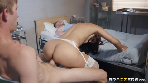 Doctor and nurse beauty fucking next to patient's bed