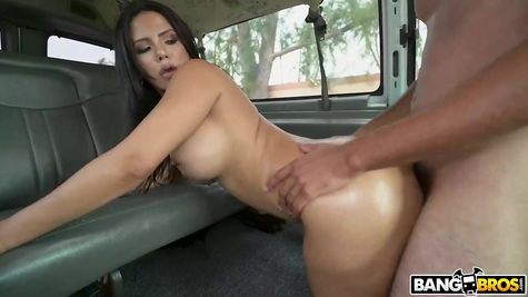 In the car, a very busty chick is fucked by a man for glory