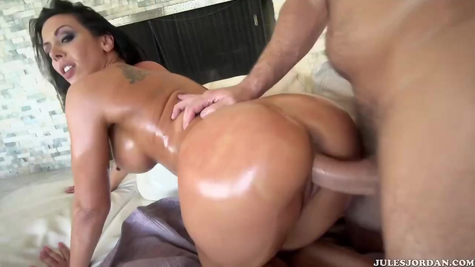 Busty oiled bitch and her big penis fucker
