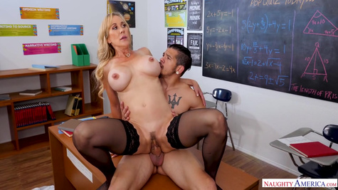 Busty teacher spread her legs in front of a student in class
