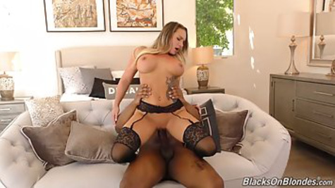 Porn with a chick in black stockings who fucks with a black man