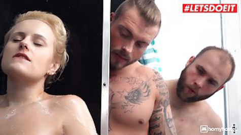 Chubby tourist with big breasts fucks with two guys in the shower
