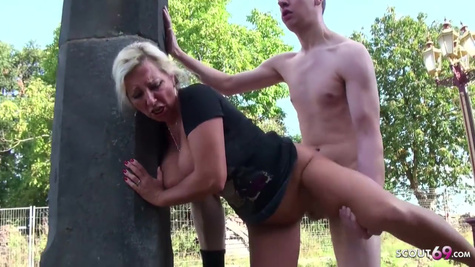 A mature lady saw her son's friend jerking off and fucked him on the street