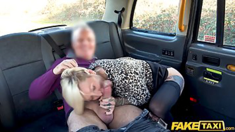 The taxi driver rolls up to a mature passenger and has her in the back seat