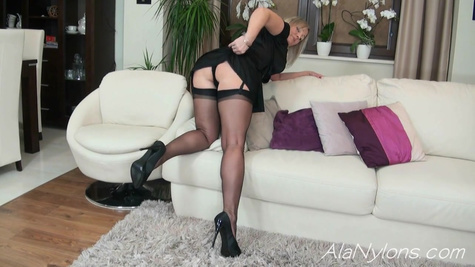 Mature woman in black dress gets up doggy style and shows underwear