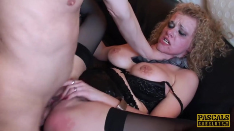A guy in a strict suit has a mature blonde in stockings hard
