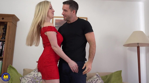 The dude takes off the red dress from the busty woman and fucks her