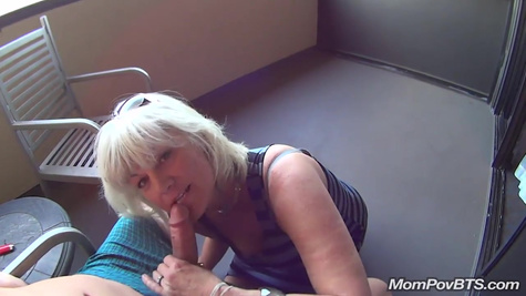 A mature blonde sucks a guy's dick on the balcony and fucks in the same place