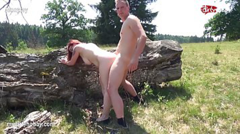 Red-haired milf with glasses gets out into nature to fuck there