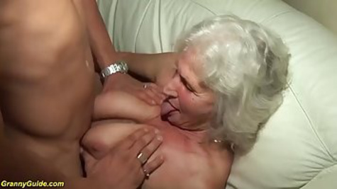 A gray-haired old woman sucks a boy's penis and gives him a pussy
