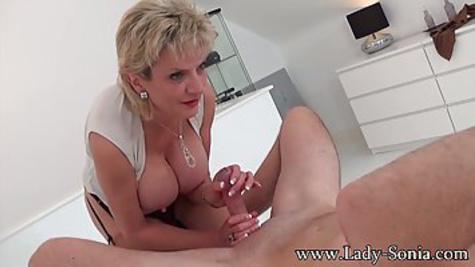 Mature lady with big tits masturbates guy's penis
