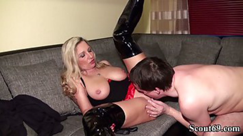 Busty German woman in high boots spreads her legs and gives a pussy