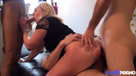 A mature French woman fucks in both holes with three partners