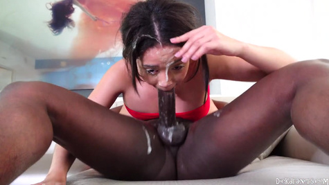 Chick, all stained with saliva, gives a deep blowjob to the negro