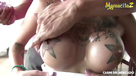 Man in a condom has a tattooed Latina with glasses