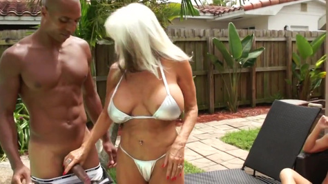 Two old women sunbathed near the pool and seduced an unfamiliar black man