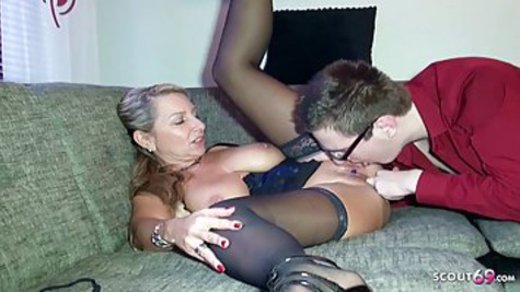 Mature German woman teaches a young guy with glasses to fuck properly