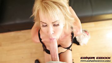 Mature bitch with tied hands gives a deep blowjob on the floor