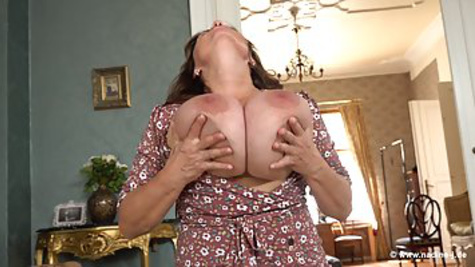 Mature woman with huge tits caresses milking at home