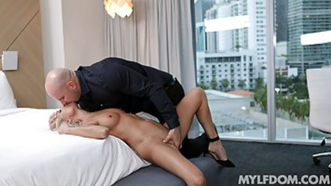 A beauty comes to a bald male and shows sexy lingerie