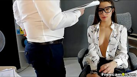 Boss watches how secretary masturbates her shaved pussy while he speaks by telephone