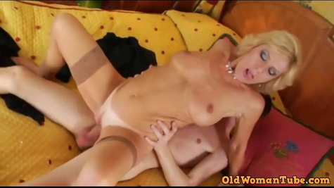 Blonde mature woman in stockings fucks with her employee in the office and sucks huge cock