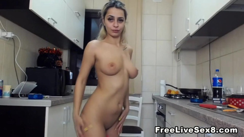 Young blonde girl sucks huge cock in the kitchen and fucks with her boyfriend in front of web camera