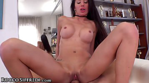 Slim brunette with big tits is riding a hard dick of her lover and screaming in front of the camera