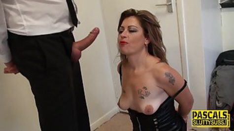 Tattooed milf is getting fucked from the back in the kitchen in front of the camera