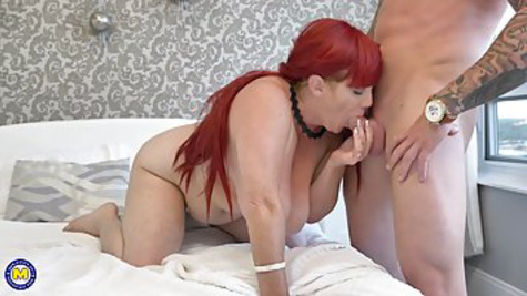 Fat tattooed red haired MILF fucks with her husband and makes a blowjob in the bed