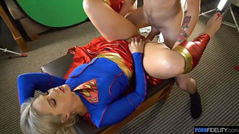 Sexy blonde girl in a super heroine costume fucks with her husband in front of the camera