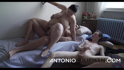 Fat mature wife is cheating on her husband and fucking with lover in the bed in front of him