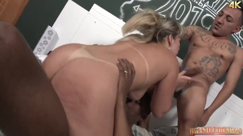 Mature blonde woman is getting fucked by two guys at the same time and enjoying it