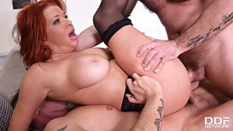 Naughty redhead woman with big boobs is sucking two cocks during a mmf threesome and trying double penetration
