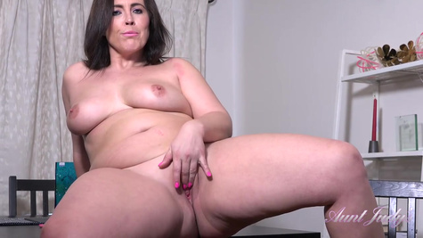 Fat mature lady with huge natural tits is masturbating shaved pussy by her fingers