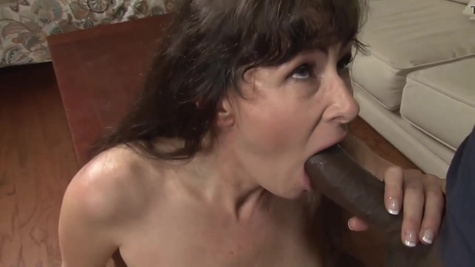 Mature brunette woman with big boobs is trying interracial sex with black man and fucking inside shaved pussy