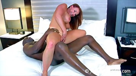 Red haired mature woman Janet Mason with big boobs likes to fuck a black dude