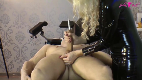 Cock loving blonde in a black, latex suit knows how to make every guy cum