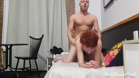 Mature man makes a home video and fucks a red haired lover in the bed by huge cock