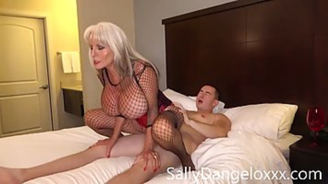 Blonde milf with massive tits is fucking with her younger lover in the bedroom and moaning from a pleasure