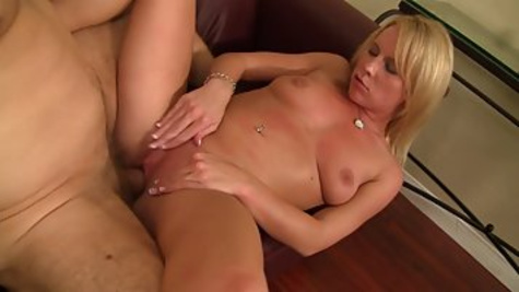 Horny blonde milf sucks a dick of her husband in the living room and gets it deep inside her shaved pussy