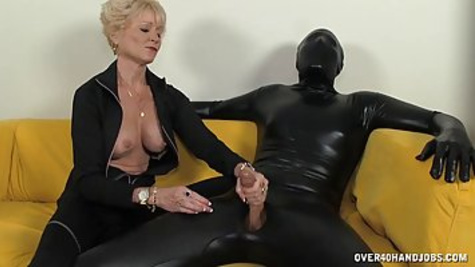 Naughty blonde woman with big tits is jerking off a huge cock of the mature man on the coach