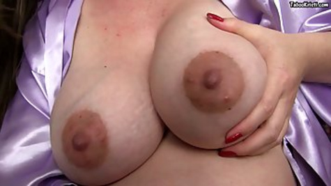The brunette MILF with big boobs makes a solo show and undresses herself naked in front of the camera