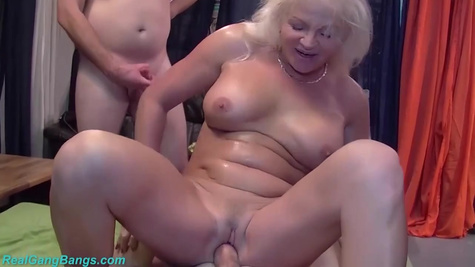 Horny elderly woman with big, firm tits is getting gangbanged for the first time ever