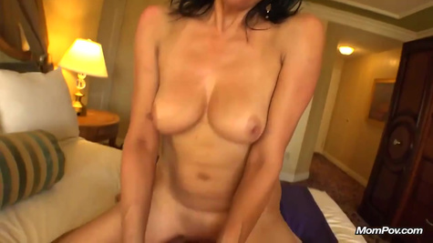 The mature wife with big boobs makes a hardcore sex with her husband in the bedroom in front of the camera