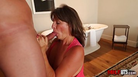 The naughty brunette woman with big boobs is cheating on her husband and fucking in the doggy style pose