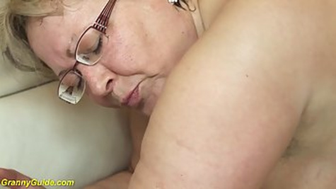 Chubby blonde granny in black stockings is getting her hairy pussy drilled by huge cock on the couch